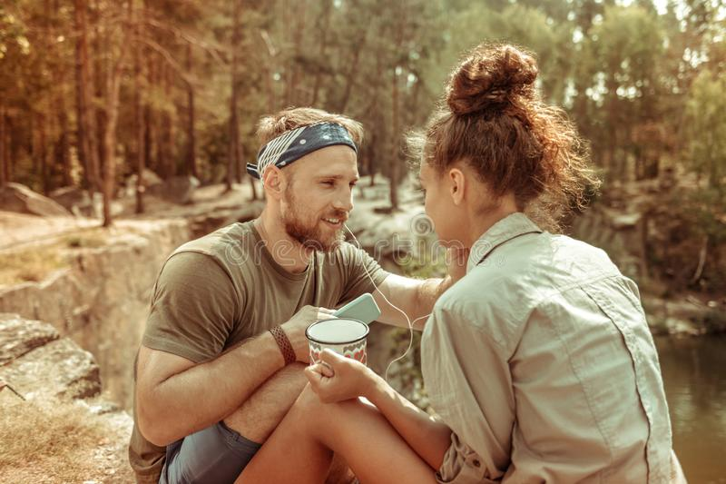 Nice young couple resting in the forest together royalty free stock photos