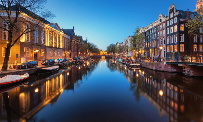 Beautiful night cityscape with canals of Amsterdam, Netherlands stock photography