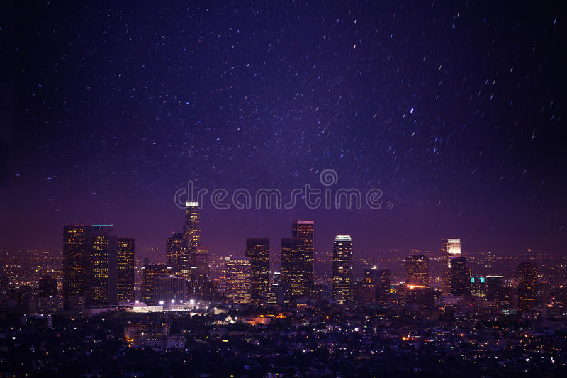 Beautiful night cityscape view of Los Angeles, US. Beautiful night cityscape view of Los Angeles from Griffith Observatory with lights and shine of stars in the royalty free stock image