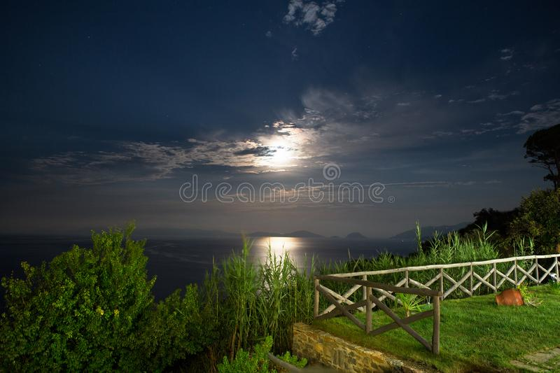 A beautiful night with a full moon and a starry sky on the island of Skopelos in the Aegean Sea in Greece stock images