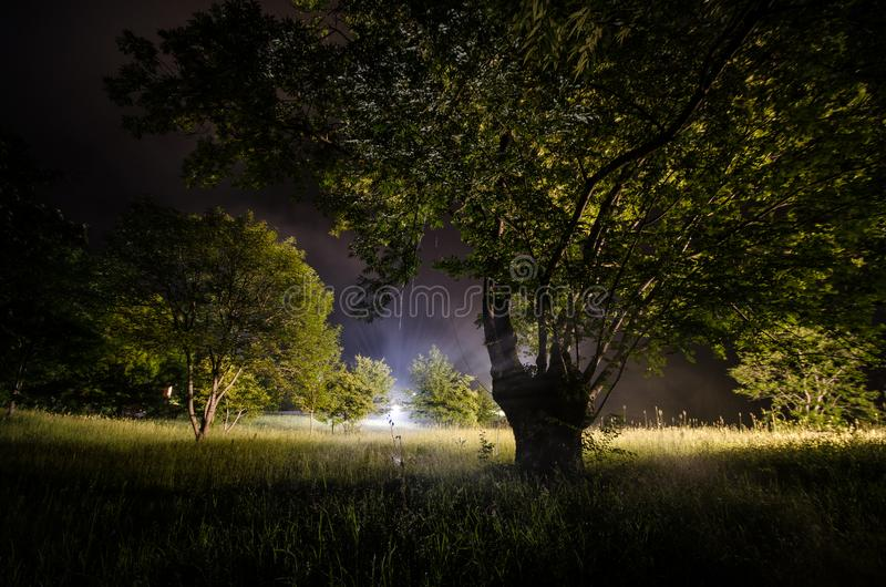 Beautiful night landscape of big full moon rising over the mountain road with hill and trees, mystical concept. Beautiful night landscape of big full moon rising royalty free stock images