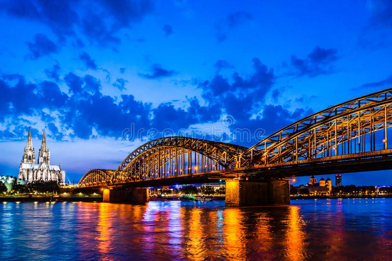 Beautiful night landscape of the Cologne, Germany with gothic cathedral, Hohenzollern Bridge and reflections over the River Rhine stock photography