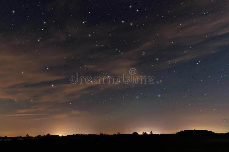 Beautiful night sky, with clouds and constellations. Hercules, Draco, Ursa Major, Ursa Minor, Big Dipper, Botes royalty free stock photos