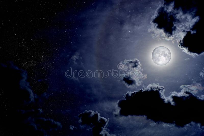 Beautiful night sky with clouds and full moon stock photos