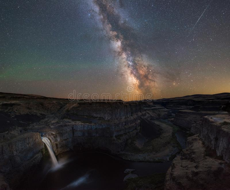 Milky Way Galaxy over Palouse Falls in Washington State. Beautiful night sky and milky way galaxy over Palouse Falls in Washington State royalty free stock photo