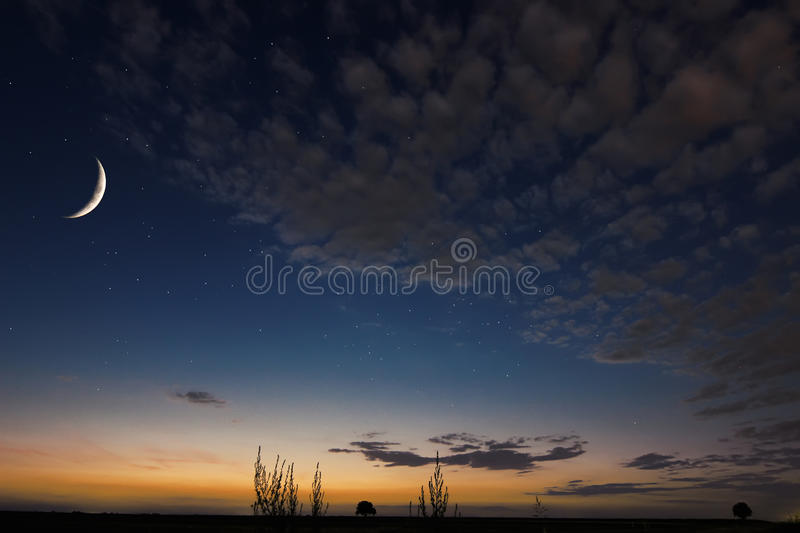 Beautiful night sky,moon, Beautiful clouds on night background. Moon Waning Crescent. Ramadan background stock photography