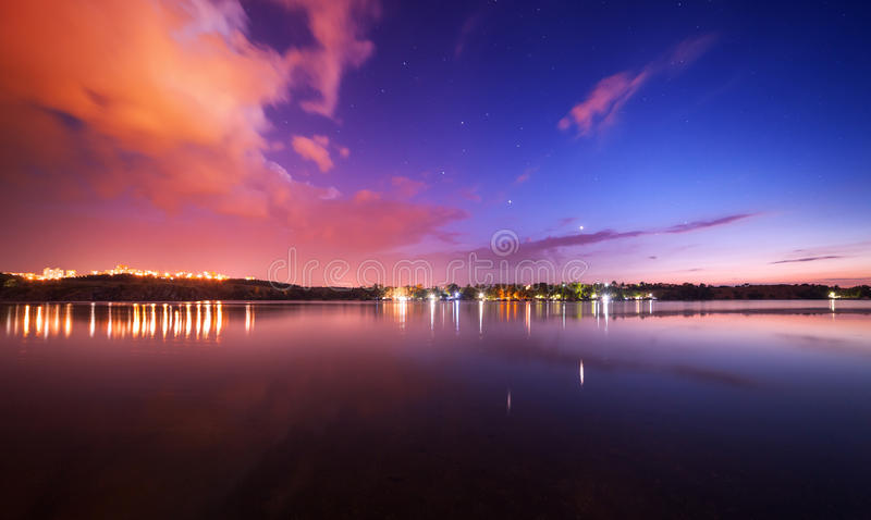Beautiful night sky at the river with stars and clouds. Beautiful night sky at the river with stars, clouds and reflections in the water. Summer in Ukraine royalty free stock images