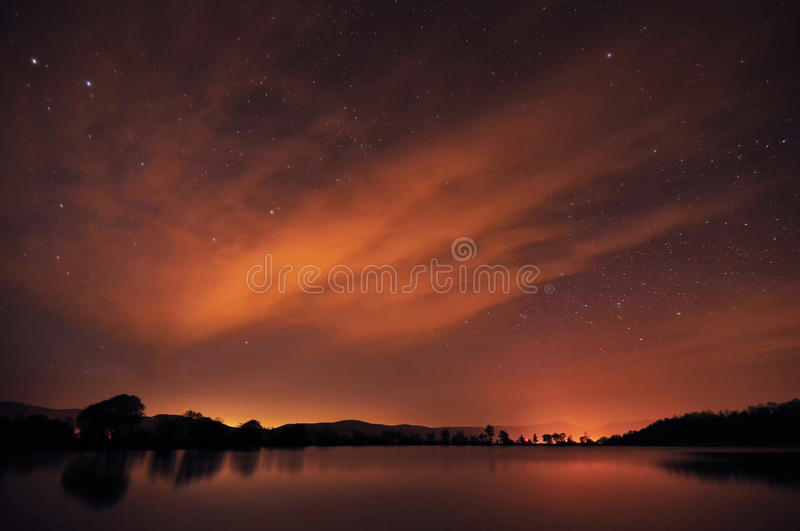 Beautiful night sky with stars, clouds and reflections in the wa. Ter. Spring in Crimea stock photos