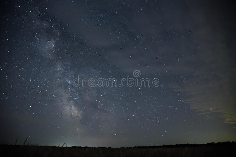 Beautiful night sky with stars. Milky Way over field stock photos