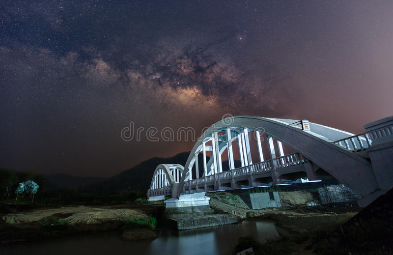Beautiful Night Starry sky with Rising Milky Way over the bridge stock images