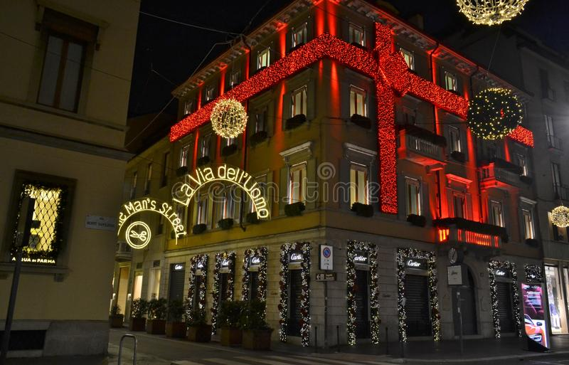 Beautiful night view to the decorated for the Christmas in red stripes Cartier fashion boutique. Milan/Italy - January 1, 2016: Beautiful night view to the stock photography