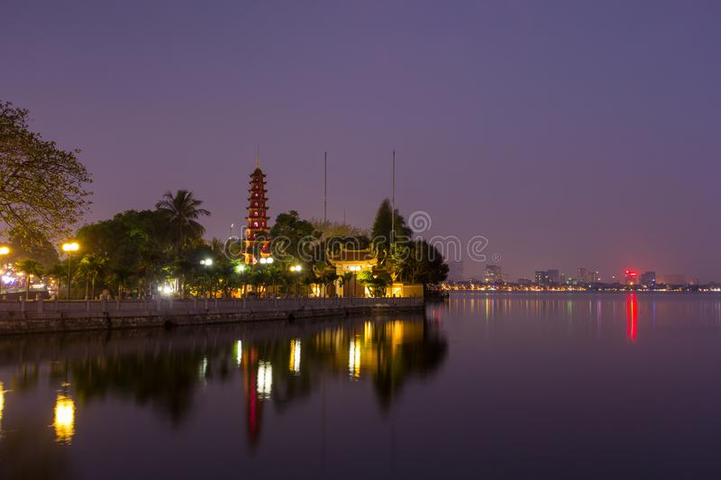Beautiful night view of the Tran Quoc Pagoda on the small peninsula. The most ancient pagoda in Hanoi, originally constructed in the 6th century, East side of stock photography