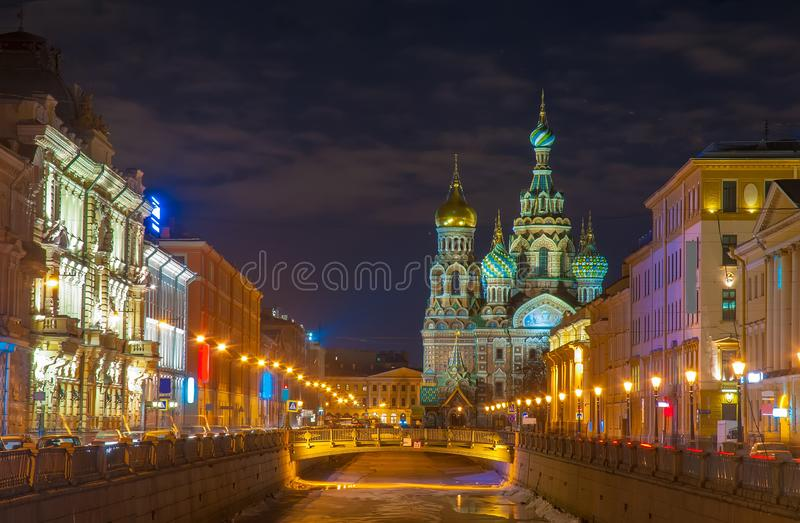 Beautiful nightscape of Church of the Savior on Spilled Blood over Griboyedov canal at twilight, St Petersburg, Russia stock photo