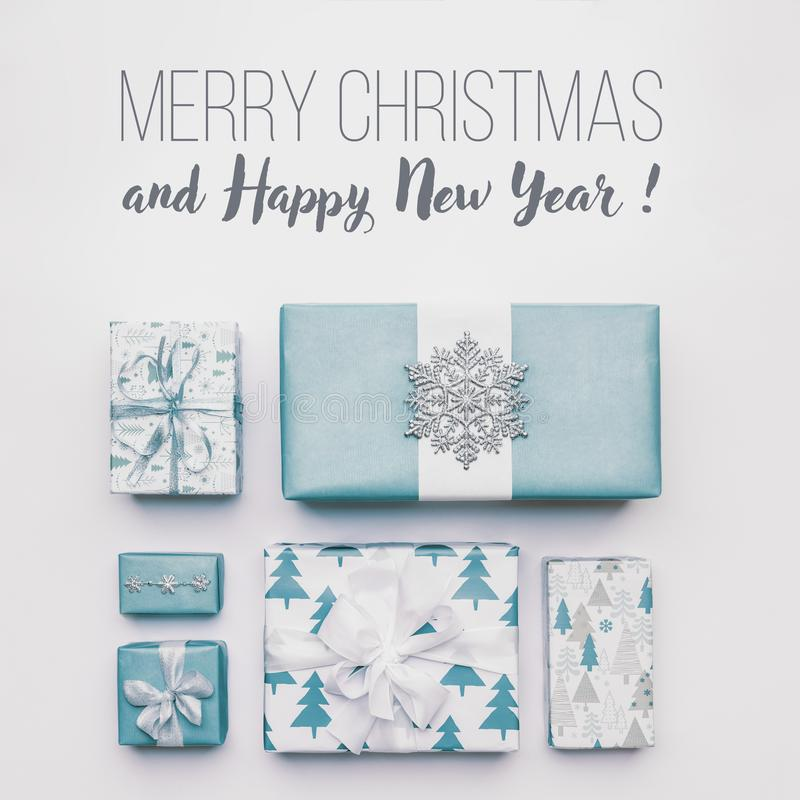 Beautiful nordic christmas gifts isolated on white background. Pastel blue colored wrapped xmas boxes. Gift wrapping. stock photography