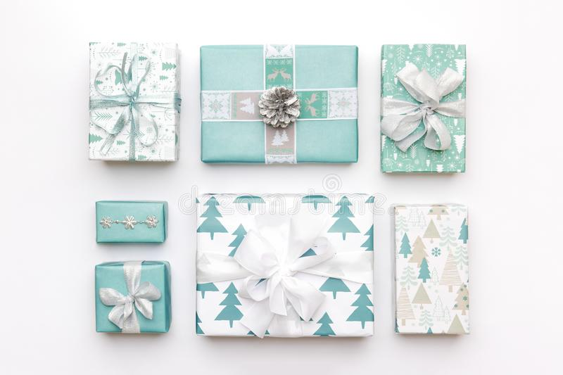 Beautiful nordic christmas gifts isolated on white background. Turquoise colored wrapped xmas boxes. Gift wrapping. stock image