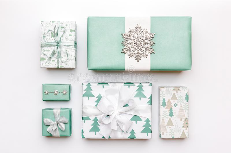 Beautiful nordic christmas gifts isolated on white background. Turquoise colored wrapped xmas boxes. Gift wrapping. Beautiful nordic christmas gifts isolated on royalty free stock photo