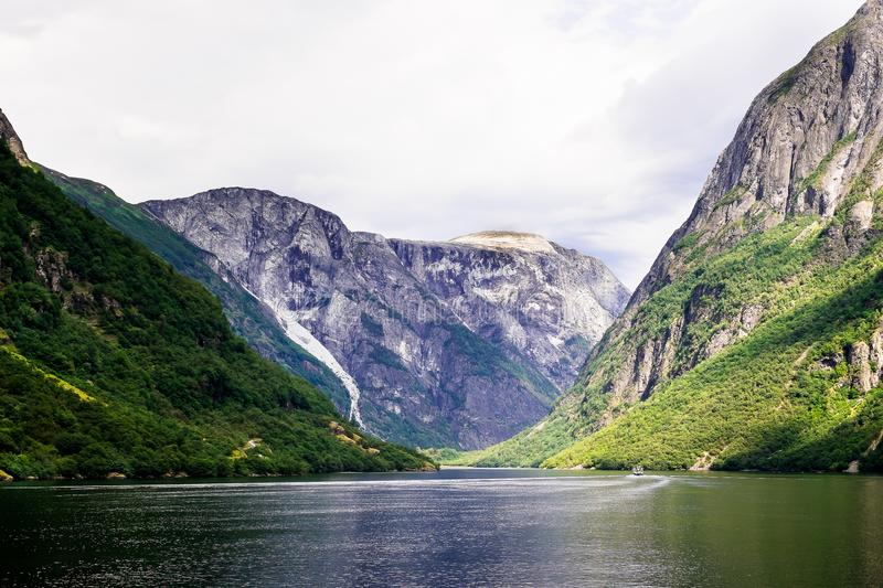 Beautiful nordic landscape with spectacular norwegian fjord - long, narrow inlet with steep sides or cliffs, created by a glacier. stock photo