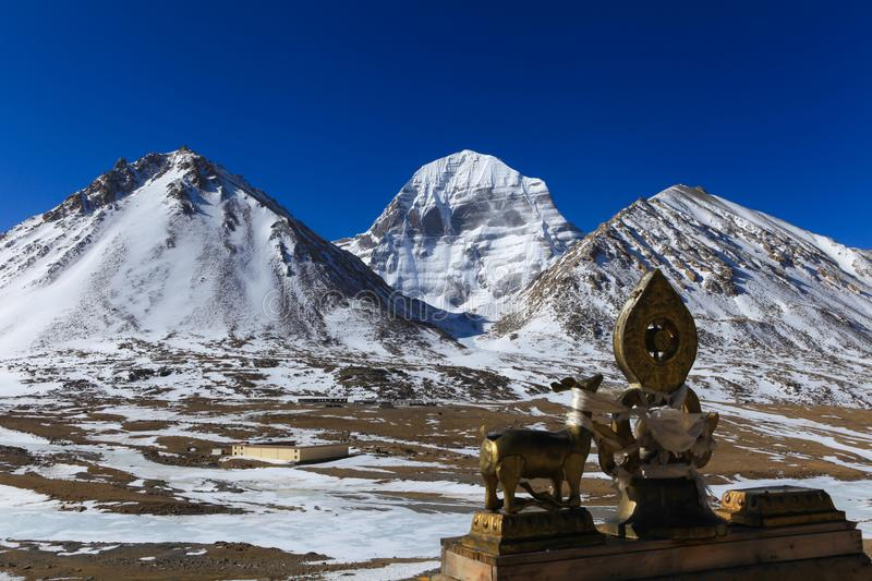 Beautiful North face of sacred Kailash mountain with golden deer and dharma wheel royalty free stock photos