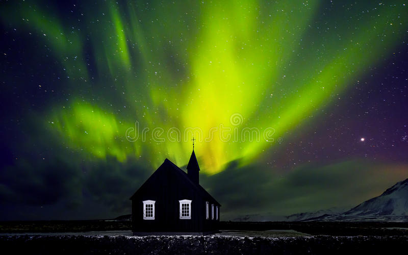 Beautiful Northern light over church stock image