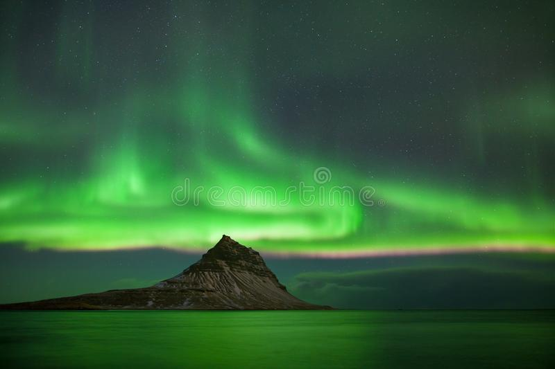 This beautiful northern lights or aurora borealis in Iceland was taken at or around Kirkjufell mountain near Grundarfjordur. stock photography