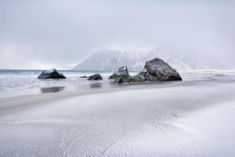 Beautiful Norway landscape of picturesque stones on the arctic beach of cold Norwegian Sea stock photo