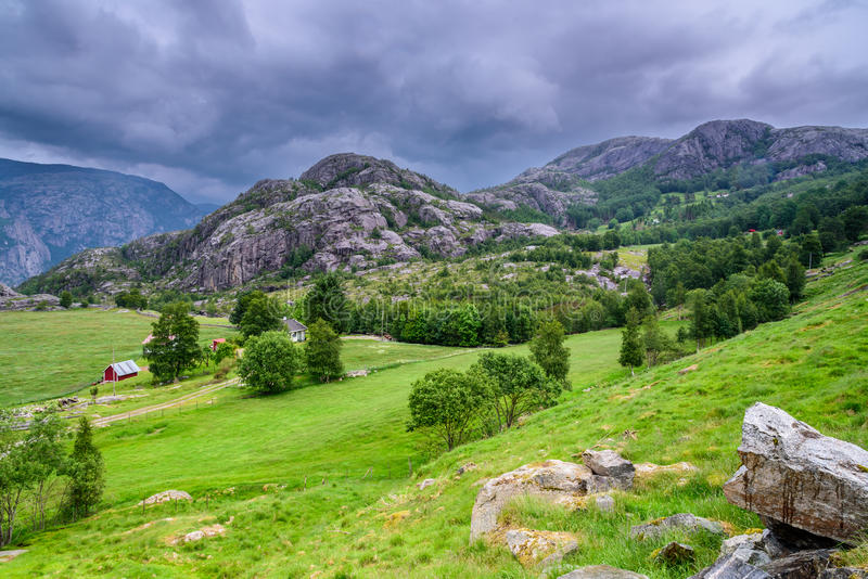 Beautiful Norwegian landscape in the mountains - storm approaching. Beautiful panorama of a mountain valley in Norway with forests in the foreground and storm royalty free stock photos