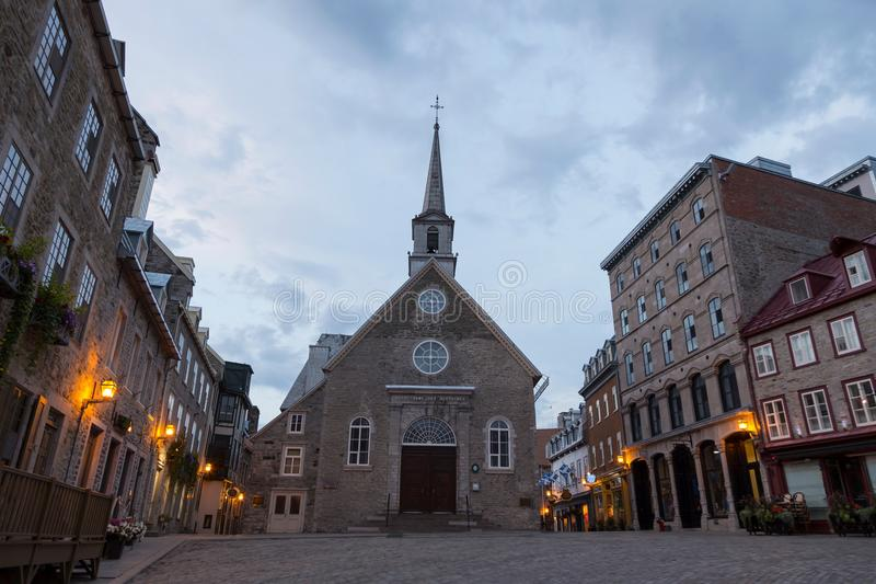 Notre-Dame-des-Victoires church and houses on Place Royale in the old part of Quebec City. Beautiful 1688 Notre-Dame-des-Victoires church and houses on Place royalty free stock photo