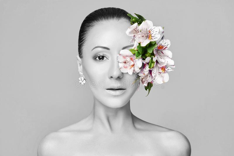 Beautiful Nude asian attractive brunette with flowers on his head. Fashion beautiful makeup, clean skin, facial care. Portrait. Of young asian beautiful woman stock image