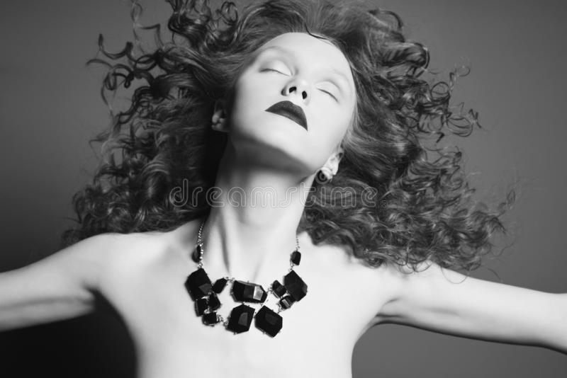 Beautiful nude woman with black jewelry. Fashion portrait royalty free stock image