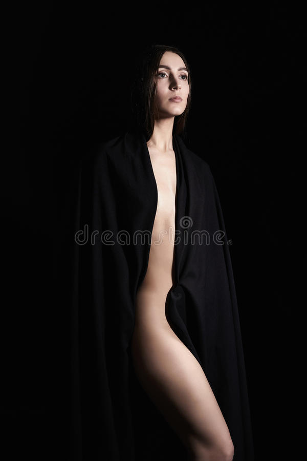 Beautiful nude woman in black textile. Fashion art beauty portrat of naked sadness girl stock photos