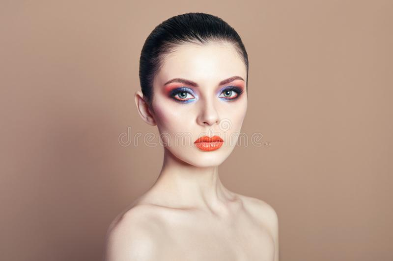 Beautiful Nude woman bright contrasting makeup on the eyes and l royalty free stock photography