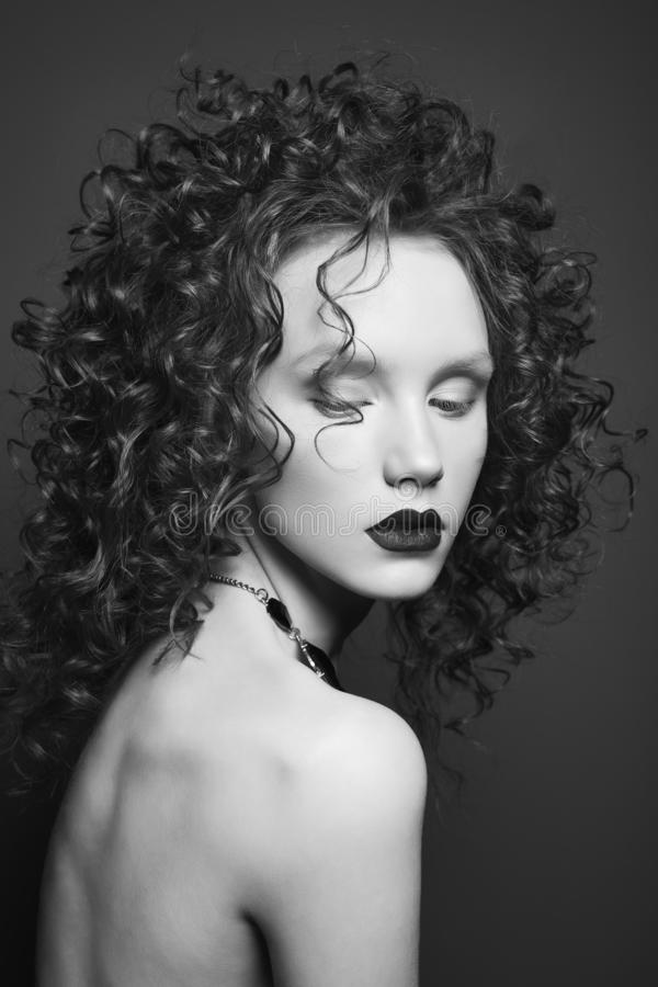 Beautiful nude woman with curly-hair and black lips royalty free stock images