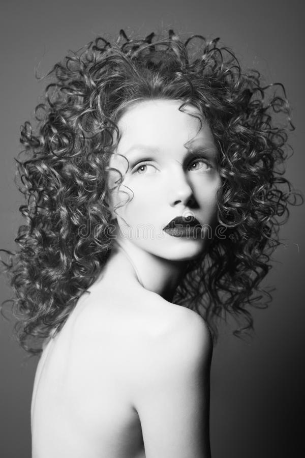 Beautiful nude woman with curly-hair and black lips royalty free stock image
