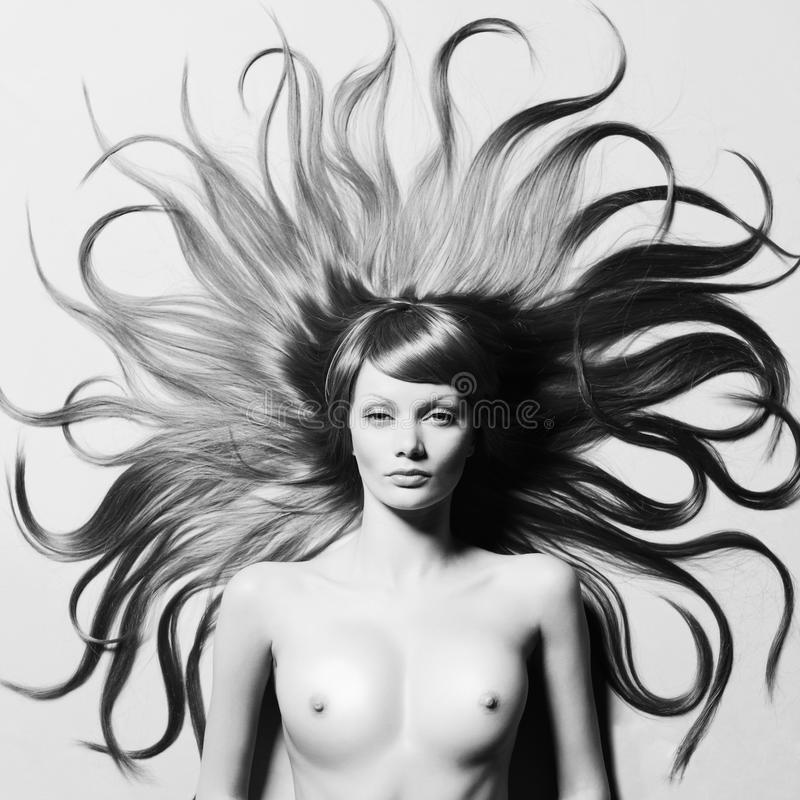 Beautiful nude woman with magnificent hair. Fashion photo of beautiful nude woman with magnificent hair stock images