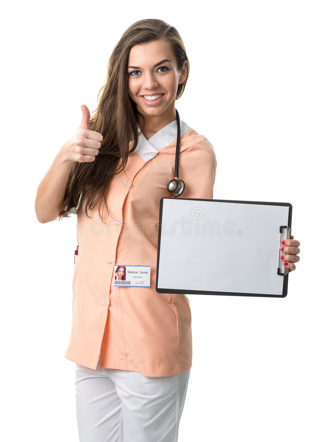 Beautiful nurse holding a folder, showing success stock photo