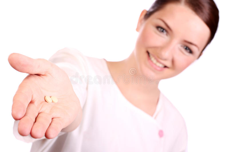 Download Beautiful Nurse Offering Two Pills Stock Images - Image: 9997994