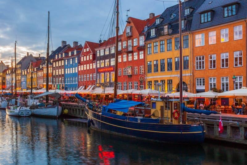 Beautiful Nyhavn at night in Copenhagen city in Denmark. Boats in marine royalty free stock photos