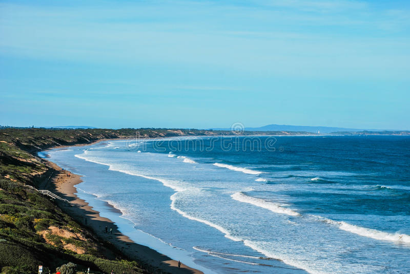 Ocean Grove shore all the way to Point Lonsdale. Victoria, Australia. Beautiful ocean beach line all the way from Ocean Grove to Point Lonsdale. Lighthouse is in stock photography