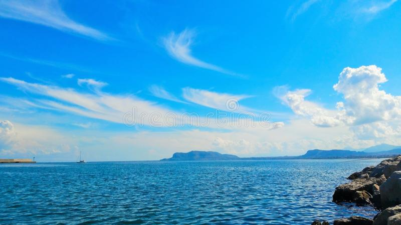 Beautiful ocean and cloud filled sky royalty free stock images