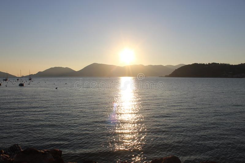 The beautiful sunset at the beach in Lerici in Italy with nice colours. royalty free stock photos