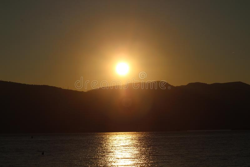The beautiful sunset at the beach in Lerici in Italy with nice colours. royalty free stock photo
