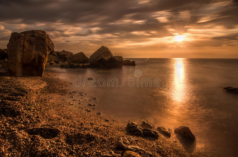 Download Beautiful Ocean Sunrise - Calm Sea And Boulders Stone Coastline Stock Photo - Image of coastline, dramatic: 41923946