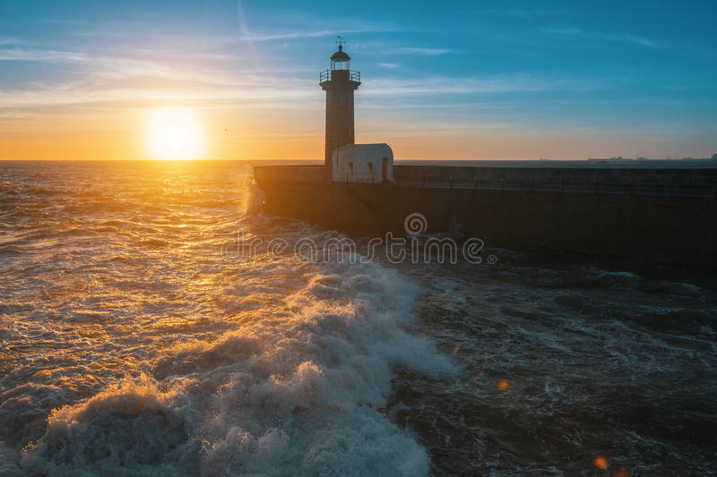 Beautiful ocean sunset and surf at the lighthouse. Nature. stock images