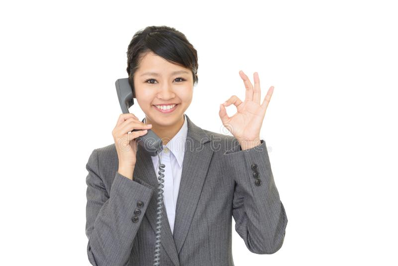Business woman with a phone. A beautiful office lady talking on the phone stock photos