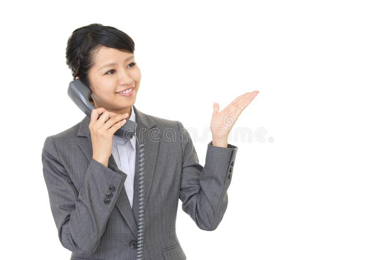 Business woman with a phone. A beautiful office lady talking on the phone royalty free stock photo