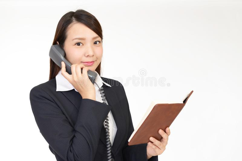 Business woman with a phone stock photos