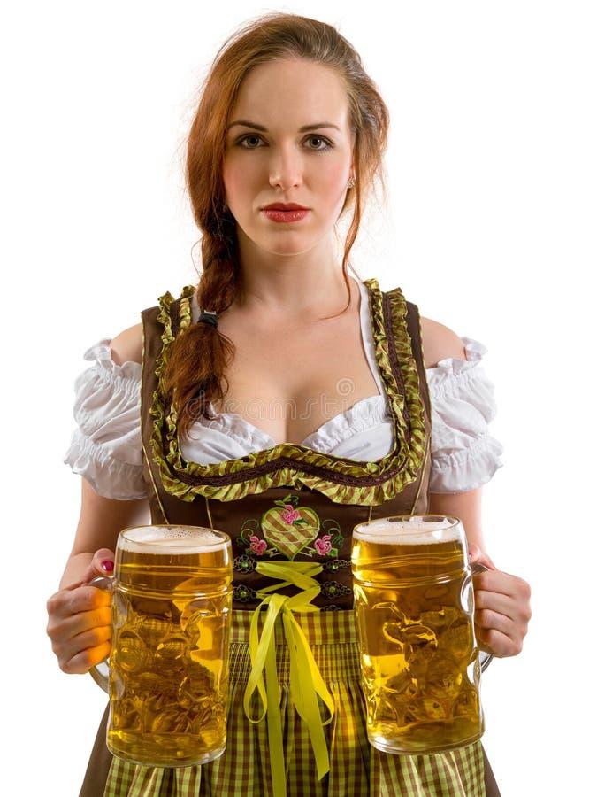 Beautiful Oktoberfest server serving beer