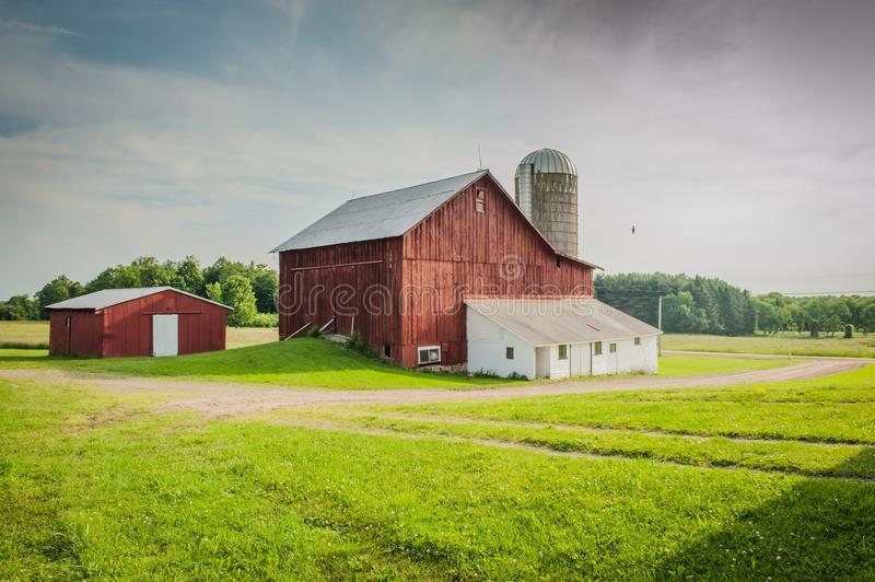 Beautiful old barn with a milkhouse in a field of rural areas of Pennsylvania. A beautiful old barn with a milkhouse in a field of rural areas of Pennsylvania royalty free stock images