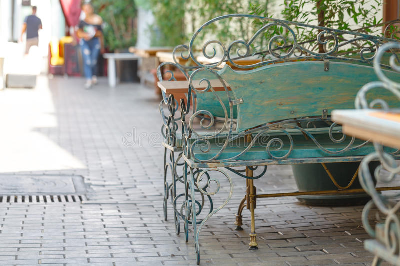 Beautiful old bench in street cafe royalty free stock images