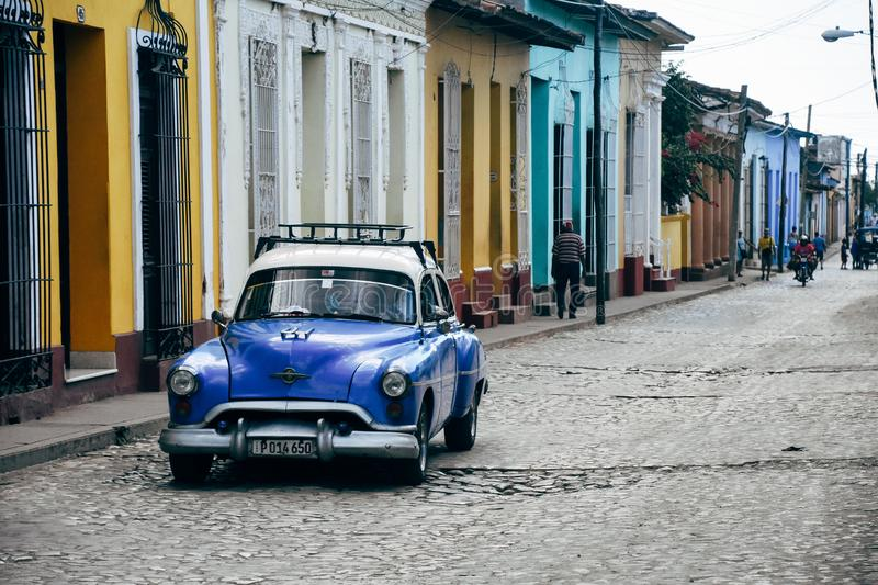 A beautiful old blue classic car in Trinidad, Cuba. A beautiful old blue classic car parked in Trinidad, Cuba royalty free stock image